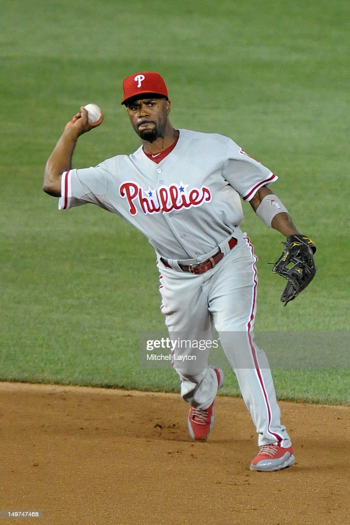 Jimmy Rollins #11 of the Philadelphia Phillies fields a ground ball during a baseball game against the Washington Capitals on July 31, 2012 at Nationals Park in Washington DC. The Phillies won 8-0.