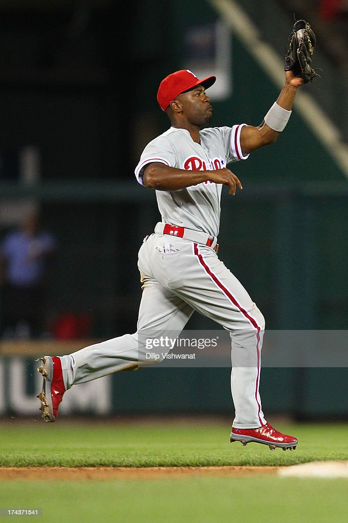 <a gi-track='captionPersonalityLinkClicked' href=/galleries/search?phrase=Jimmy+Rollins&family=editorial&specificpeople=204478 ng-click='$event.stopPropagation()'>Jimmy Rollins</a> #11 of the Philadelphia Phillies fields a one hopper against the St. Louis Cardinals in the eighth inning at Busch Stadium on July 24, 2013 in St. Louis, Missouri. The Cardinals beat the Phillies 11-3.