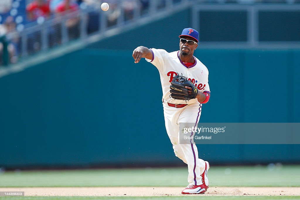 <a gi-track='captionPersonalityLinkClicked' href=/galleries/search?phrase=Jimmy+Rollins&family=editorial&specificpeople=204478 ng-click='$event.stopPropagation()'>Jimmy Rollins</a> #11 of the Philadelphia Phillies fields the ball during the game against the San Diego Padres at Citizens Bank Park on May 13, 2012 in Philadelphia, Pennsylvania. The Phillies won 3-2.