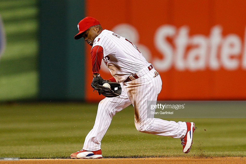 <a gi-track='captionPersonalityLinkClicked' href=/galleries/search?phrase=Jimmy+Rollins&family=editorial&specificpeople=204478 ng-click='$event.stopPropagation()'>Jimmy Rollins</a> #11 of the Philadelphia Phillies fields the ball in the fourth inning of the game against the Kansas City Royals at Citizens Bank Park on April 6, 2013 in Philadelphia, Pennsylvania. The Phillies won 4-3.