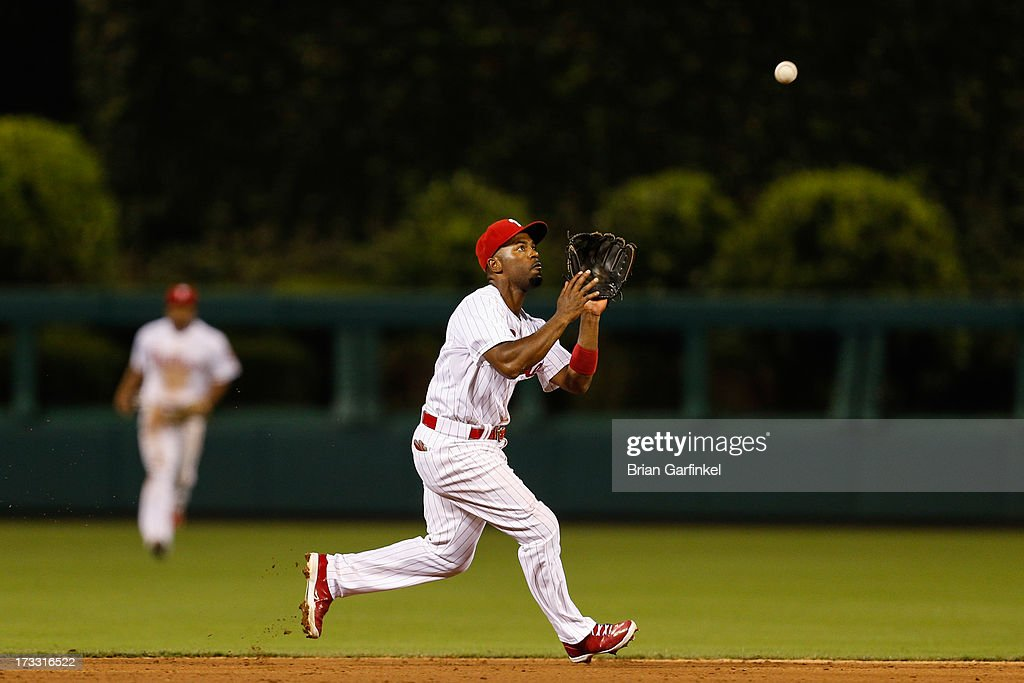 <a gi-track='captionPersonalityLinkClicked' href=/galleries/search?phrase=Jimmy+Rollins&family=editorial&specificpeople=204478 ng-click='$event.stopPropagation()'>Jimmy Rollins</a> #11 of the Philadelphia Phillies fields the ball in the sixth inning of the game against the Washington Nationals at Citizens Bank Park on July 11, 2013 in Philadelphia, Pennsylvania.