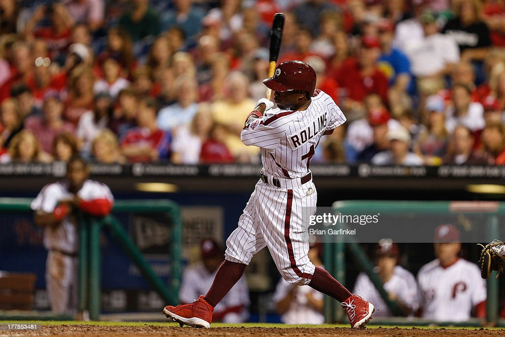 <a gi-track='captionPersonalityLinkClicked' href=/galleries/search?phrase=Jimmy+Rollins&family=editorial&specificpeople=204478 ng-click='$event.stopPropagation()'>Jimmy Rollins</a> #11 of the Philadelphia Phillies follows through on a base hit in the bottom of the ninth inning of the game against the Arizona Diamondbacks at Citizens Bank Park on August 23, 2013 in Philadelphia, Pennsylvania. The Phillies won 4-3.