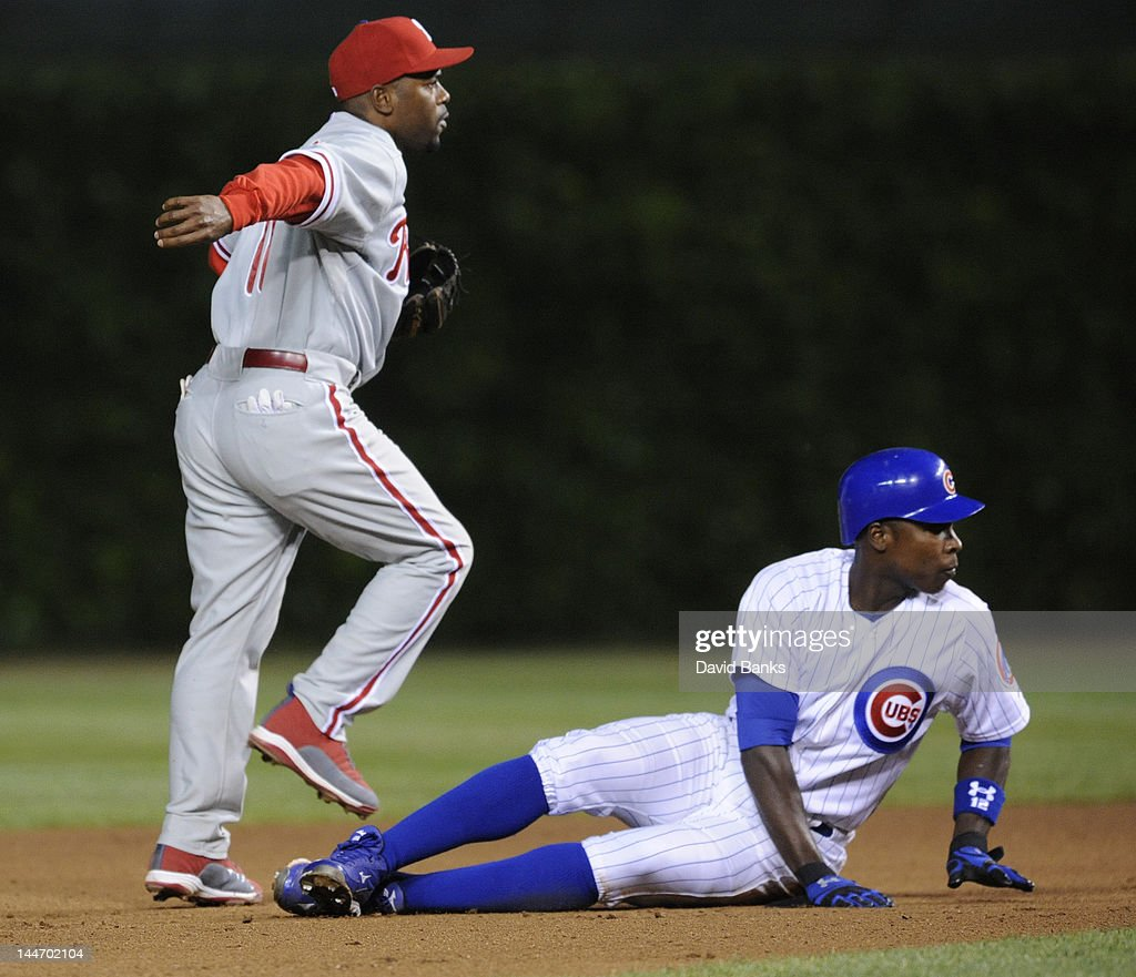 <a gi-track='captionPersonalityLinkClicked' href=/galleries/search?phrase=Jimmy+Rollins&family=editorial&specificpeople=204478 ng-click='$event.stopPropagation()'>Jimmy Rollins</a> #11 of the Philadelphia Phillies forces out <a gi-track='captionPersonalityLinkClicked' href=/galleries/search?phrase=Alfonso+Soriano&family=editorial&specificpeople=202251 ng-click='$event.stopPropagation()'>Alfonso Soriano</a> #12 of the Chicago Cubs at second base in the sixth inning on May 17, 2012 at Wrigley Field in Chicago, Illinois.