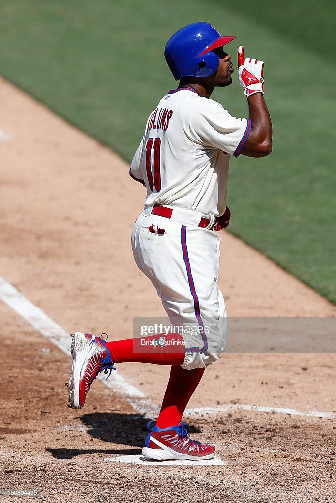 <a gi-track='captionPersonalityLinkClicked' href=/galleries/search?phrase=Jimmy+Rollins&family=editorial&specificpeople=204478 ng-click='$event.stopPropagation()'>Jimmy Rollins</a> #11 of the Philadelphia Phillies gestures after hitting a two run home run in the fifth inning of the game against the Washington Nationals at Citizens Bank Park on August 26, 2012 in Philadelphia, Pennsylvania.