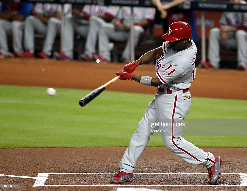 <a gi-track='captionPersonalityLinkClicked' href=/galleries/search?phrase=Jimmy+Rollins&family=editorial&specificpeople=204478 ng-click='$event.stopPropagation()'>Jimmy Rollins</a> #11 of the Philadelphia Phillies gets a base hit in the first inning against the Miami Marlins at Marlins Park on May 22, 2013 in Miami, Florida.