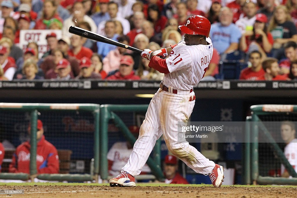 <a gi-track='captionPersonalityLinkClicked' href=/galleries/search?phrase=Jimmy+Rollins&family=editorial&specificpeople=204478 ng-click='$event.stopPropagation()'>Jimmy Rollins</a> #11 of the Philadelphia Phillies hits a home run during a game against the Miami Marlins at Citizens Bank Park on September 11, 2012 in Philadelphia, Pennsylvania. The Phillies won 9-7.