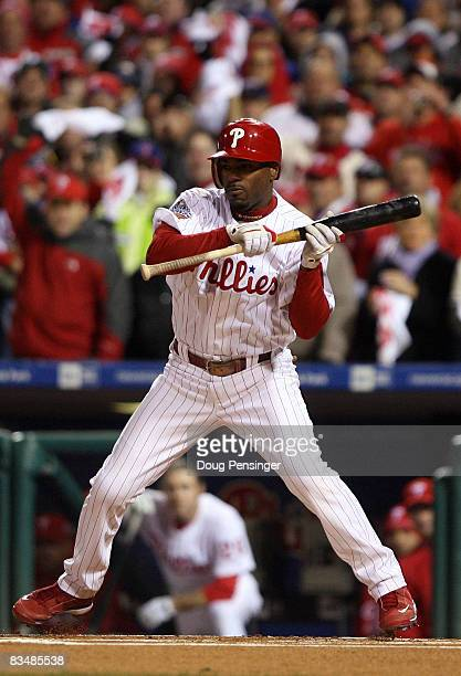 Jimmy Rollins of the Philadelphia Phillies hits a sacrifice bunt to advance Geoff Jenkins to third base in the bottom of the sixth inning against the...