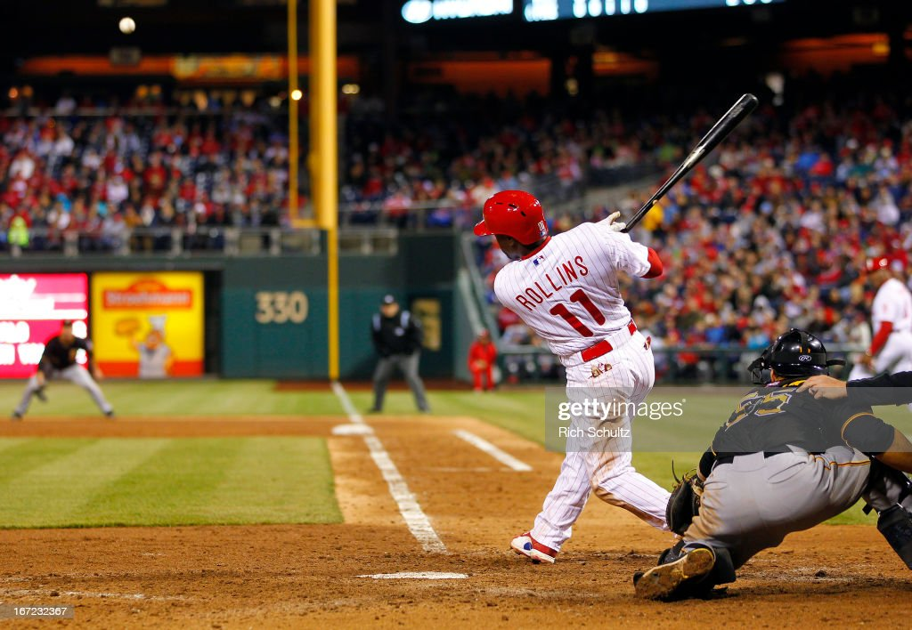 <a gi-track='captionPersonalityLinkClicked' href=/galleries/search?phrase=Jimmy+Rollins&family=editorial&specificpeople=204478 ng-click='$event.stopPropagation()'>Jimmy Rollins</a> #11 of the Philadelphia Phillies hits a single to right field scoring teammate Erik Kratz #31 for the go ahead run in the sixth inning against of the Pittsburgh Pirates in a MLB baseball game on April 22, 2013 at Citizens Bank Park in Philadelphia, Pennsylvania. The Phillies defeated the Pirates 3-2.
