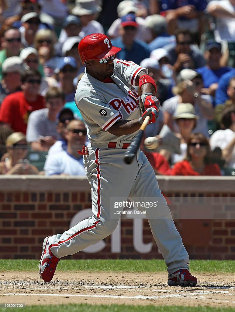 Jimmy Rollins #11 of the Philadelphia Phillies hits the ball against the Chicago Cubs at Wrigley Field on July 16, 2010 in Chicago, Illinois. The Cubs defeated the Phillies 4-3.