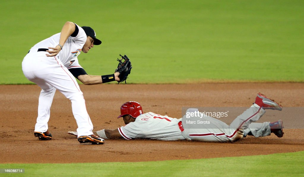 Jimmy Rollins #11 of the Philadelphia Phillies is caught stealing in the first inning by Second baseman Derek Dietrich #51 of the Miami Marlins at Marlins Park on May 22, 2013 in Miami, Florida.