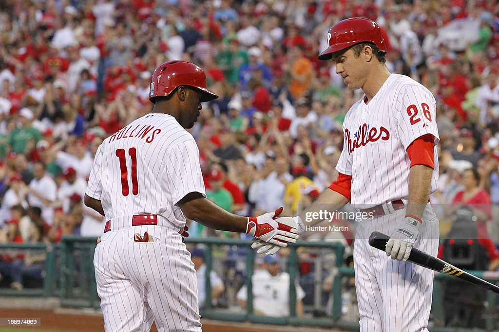 <a gi-track='captionPersonalityLinkClicked' href=/galleries/search?phrase=Jimmy+Rollins&family=editorial&specificpeople=204478 ng-click='$event.stopPropagation()'>Jimmy Rollins</a> #11 of the Philadelphia Phillies is congratulated after scoring a run in the third inning during a game against the Cincinnati Reds at Citizens Bank Park on May 17, 2013 in Philadelphia, Pennsylvania. It was Rollins' 1200th run scored in his career. The Phillies won 5-3.