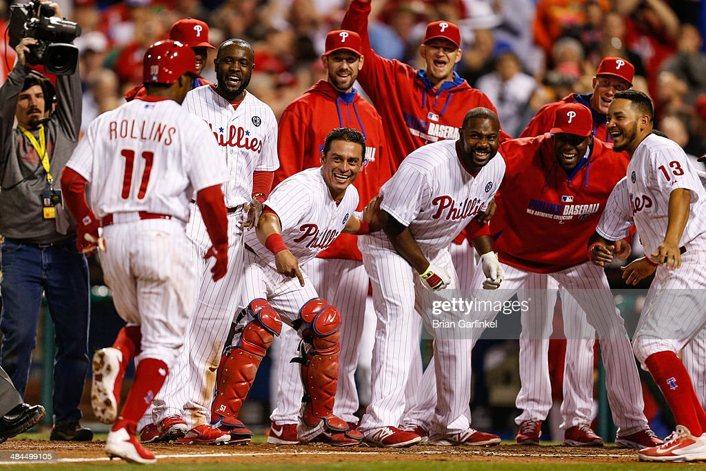 <a gi-track='captionPersonalityLinkClicked' href=/galleries/search?phrase=Jimmy+Rollins&family=editorial&specificpeople=204478 ng-click='$event.stopPropagation()'>Jimmy Rollins</a> #11 of the Philadelphia Phillies is greeted by teammates at home plate after hitting a walk off home run in the tenth inning of the game against the Miami Marlins at Citizens Bank Park on April 12, 2014 in Philadelphia, Pennsylvania. The Phillies won 5-4 in the tenth inning.