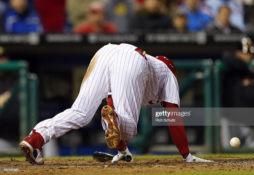<a gi-track='captionPersonalityLinkClicked' href=/galleries/search?phrase=Jimmy+Rollins&family=editorial&specificpeople=204478 ng-click='$event.stopPropagation()'>Jimmy Rollins</a> #11 of the Philadelphia Phillies is hit by a pitch with the basses loaded allowing teammate Michael Young to score in the fourth inning against the Pittsburgh Pirates in a MLB baseball game on April 22, 2013 at Citizens Bank Park in Philadelphia, Pennsylvania. The Phillies defeated the Pirates 3-2.