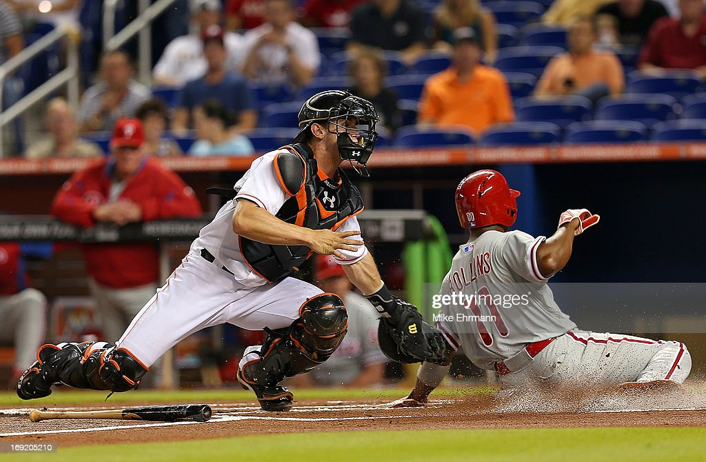 Jimmy Rollins #11 of the Philadelphia Phillies is tagged out by Rob Brantly #19 of the Miami Marlins during a game at Marlins Park on May 21, 2013 in Miami, Florida.
