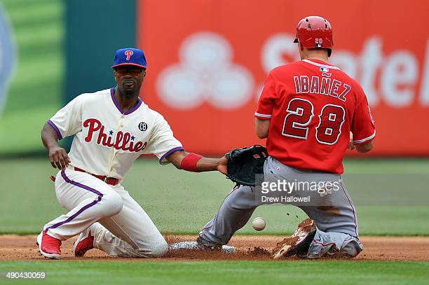 Jimmy Rollins of the Philadelphia Phillies is unable to catch the ball on a successful steal by Raul Ibanez of the Los Angeles Angels in the first...