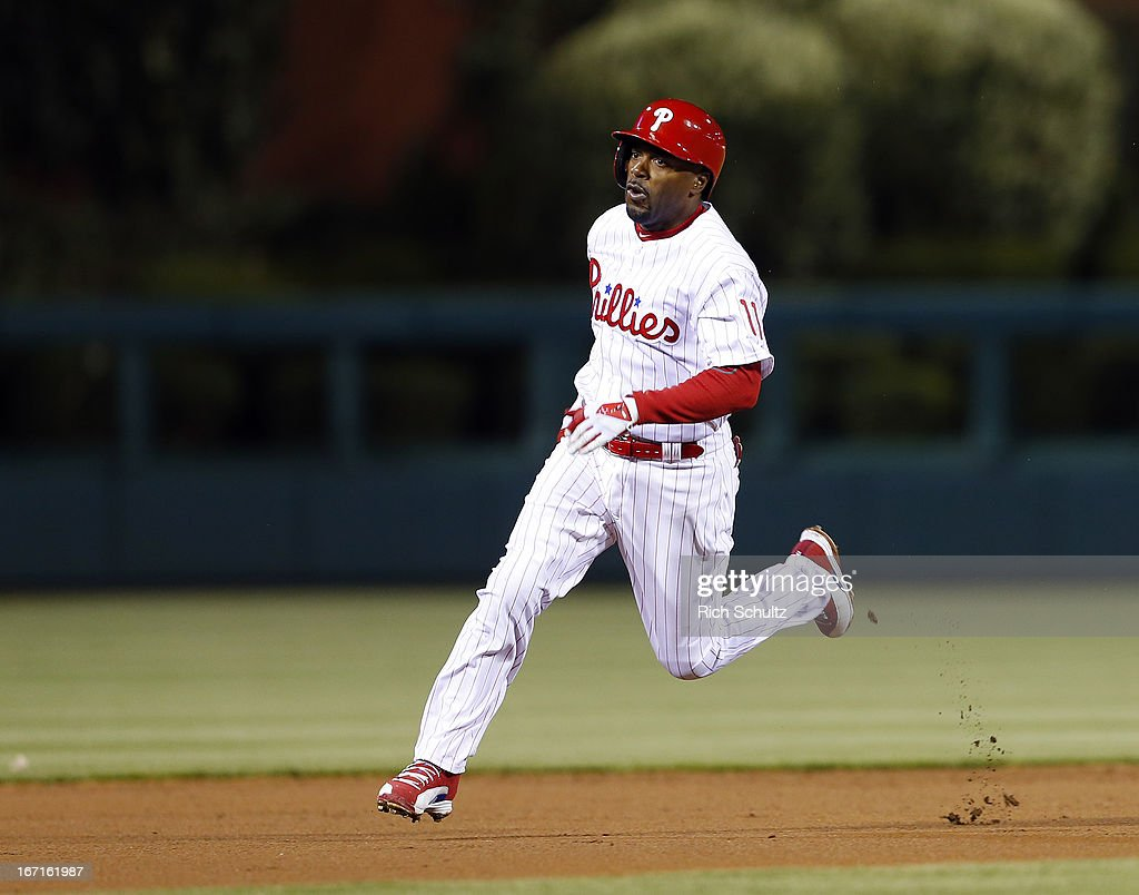 <a gi-track='captionPersonalityLinkClicked' href=/galleries/search?phrase=Jimmy+Rollins&family=editorial&specificpeople=204478 ng-click='$event.stopPropagation()'>Jimmy Rollins</a> #11 of the Philadelphia Phillies rounds second base and heads to third for a triple against the St. Louis Cardinals during the first inning in a MLB baseball game on April 21, 2013 at Citizens Bank Park in Philadelphia, Pennsylvania.