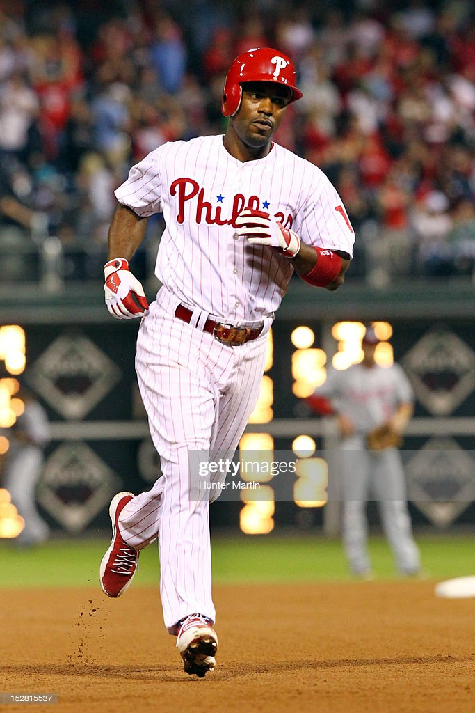Jimmy Rollins #11 of the Philadelphia Phillies rounds the bases after hitting a home run during a game against the Washington Nationals at Citizens Bank Park on September 26, 2012 in Philadelphia, Pennsylvania. The Nationals won 8-4.