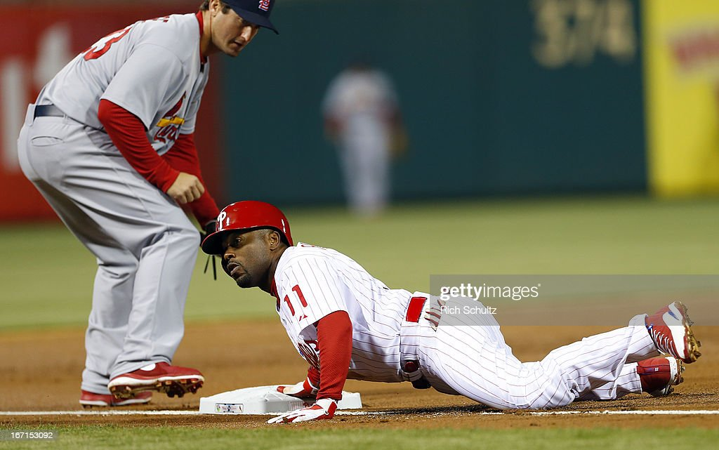 <a gi-track='captionPersonalityLinkClicked' href=/galleries/search?phrase=Jimmy+Rollins&family=editorial&specificpeople=204478 ng-click='$event.stopPropagation()'>Jimmy Rollins</a> #11 of the Philadelphia Phillies slides into third base safely for a triple as <a gi-track='captionPersonalityLinkClicked' href=/galleries/search?phrase=David+Freese+-+Baseball+Player&family=editorial&specificpeople=4948315 ng-click='$event.stopPropagation()'>David Freese</a> #23 of the St. Louis Cardinals makes a late tag during the first inning in a MLB baseball game on April 21, 2013 at Citizens Bank Park in Philadelphia, Pennsylvania.