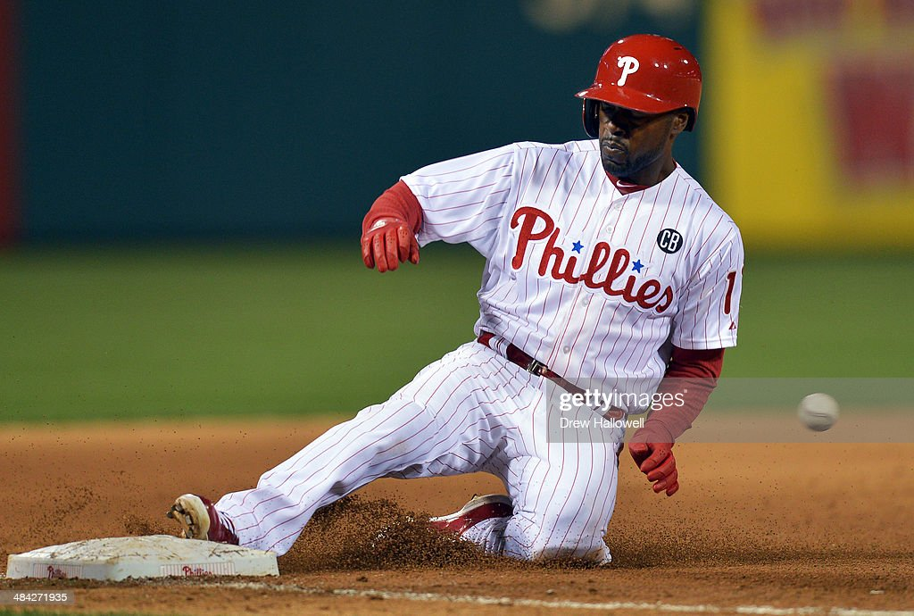 <a gi-track='captionPersonalityLinkClicked' href=/galleries/search?phrase=Jimmy+Rollins&family=editorial&specificpeople=204478 ng-click='$event.stopPropagation()'>Jimmy Rollins</a> #11 of the Philadelphia Phillies slides into third for a triple in the fifth inning against the Miami Marlins at Citizens Bank Park on April 11, 2014 in Philadelphia, Pennsylvania. The Phillies won 6-3.