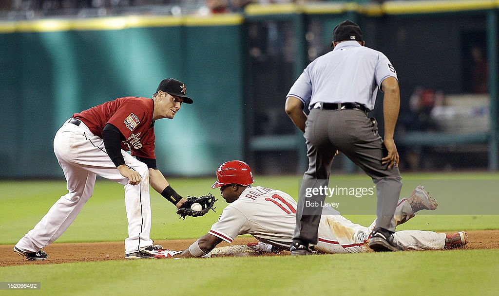 <a gi-track='captionPersonalityLinkClicked' href=/galleries/search?phrase=Jimmy+Rollins&family=editorial&specificpeople=204478 ng-click='$event.stopPropagation()'>Jimmy Rollins</a> #11 of the Philadelphia Phillies steals second base as Tyler Greene #23 of the Houston Astros applies the tag at Minute Maid Park on September 16, 2012 in Houston, Texas. Houston wins 7-6.
