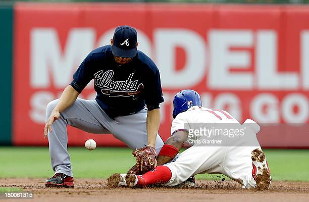 Jimmy Rollins of the Philadelphia Phillies steals second base as Andrelton Simmons of the Atlanta Braves looses control of the throw during the first...