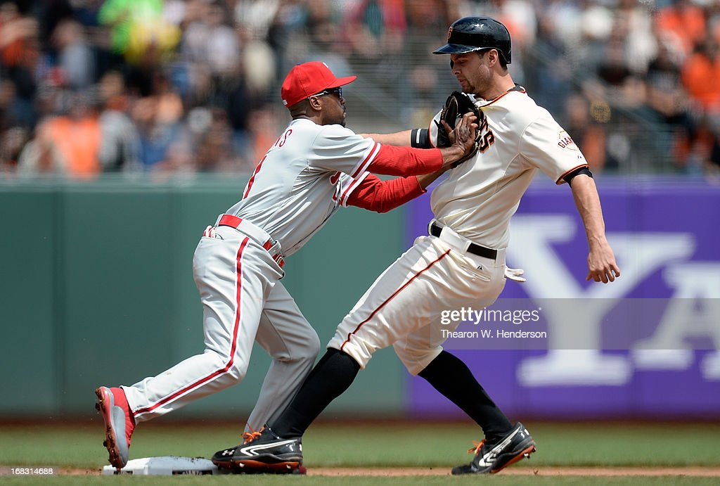 <a gi-track='captionPersonalityLinkClicked' href=/galleries/search?phrase=Jimmy+Rollins&family=editorial&specificpeople=204478 ng-click='$event.stopPropagation()'>Jimmy Rollins</a> #11 of the Philadelphia Phillies tags out <a gi-track='captionPersonalityLinkClicked' href=/galleries/search?phrase=Brandon+Belt&family=editorial&specificpeople=7513394 ng-click='$event.stopPropagation()'>Brandon Belt</a> #9 of the San Francisco Giants at second base in the fouth inning at AT&T Park on May 8, 2013 in San Francisco, California.
