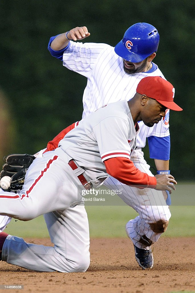<a gi-track='captionPersonalityLinkClicked' href=/galleries/search?phrase=Jimmy+Rollins&family=editorial&specificpeople=204478 ng-click='$event.stopPropagation()'>Jimmy Rollins</a> #11 of the Philadelphia Phillies tags out <a gi-track='captionPersonalityLinkClicked' href=/galleries/search?phrase=David+DeJesus&family=editorial&specificpeople=206765 ng-click='$event.stopPropagation()'>David DeJesus</a> #9 of the Chicago Cubs on a steal attempt at second base in the third inning on May 17, 2012 at Wrigley Field in Chicago, Illinois.