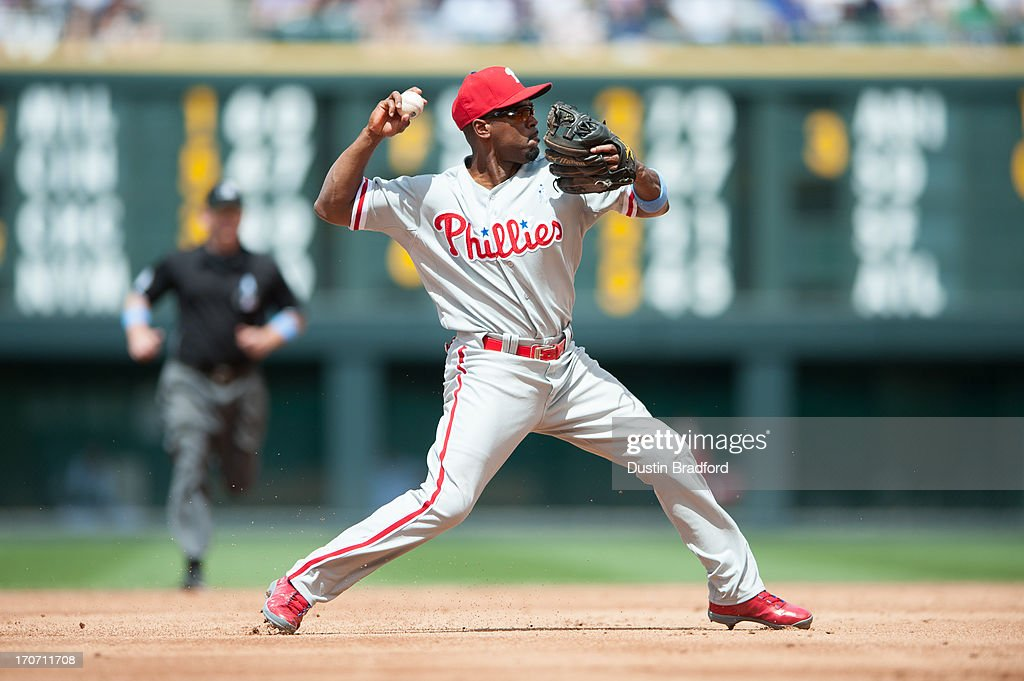 <a gi-track='captionPersonalityLinkClicked' href=/galleries/search?phrase=Jimmy+Rollins&family=editorial&specificpeople=204478 ng-click='$event.stopPropagation()'>Jimmy Rollins</a> #11 of the Philadelphia Phillies throws out a Colorado Rockies baserunner during a game at Coors Field on June 16, 2013 in Denver, Colorado. The Rockies beat the Phillies 5-2.