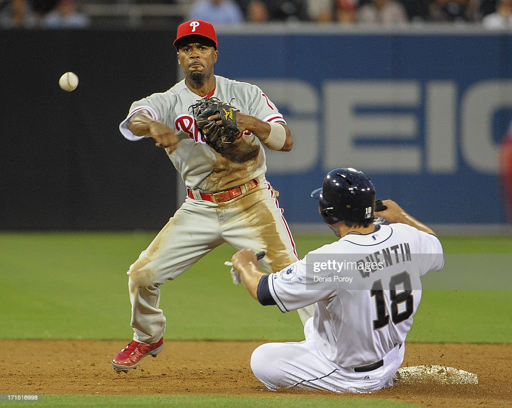 <a gi-track='captionPersonalityLinkClicked' href=/galleries/search?phrase=Jimmy+Rollins&family=editorial&specificpeople=204478 ng-click='$event.stopPropagation()'>Jimmy Rollins</a> #11 of the Philadelphia Phillies throws over <a gi-track='captionPersonalityLinkClicked' href=/galleries/search?phrase=Carlos+Quentin&family=editorial&specificpeople=836474 ng-click='$event.stopPropagation()'>Carlos Quentin</a> #18 of the San Diego Padres as he turn a double play during the third inning of a baseball game at Petco Park on June 25, 2013 in San Diego, California.