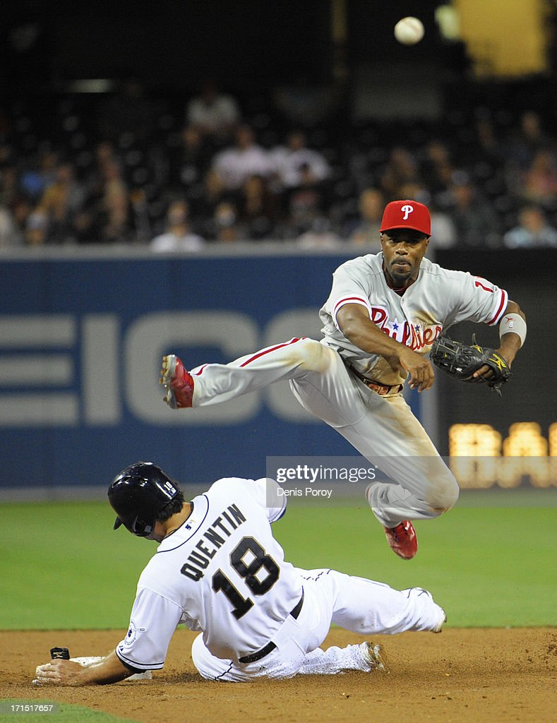 <a gi-track='captionPersonalityLinkClicked' href=/galleries/search?phrase=Jimmy+Rollins&family=editorial&specificpeople=204478 ng-click='$event.stopPropagation()'>Jimmy Rollins</a> #11 of the Philadelphia Phillies throws over <a gi-track='captionPersonalityLinkClicked' href=/galleries/search?phrase=Carlos+Quentin&family=editorial&specificpeople=836474 ng-click='$event.stopPropagation()'>Carlos Quentin</a> #18 of the San Diego Padres as he tries to turn a double play during the sixth inning of a baseball game at Petco Park on June 25, 2013 in San Diego, California.