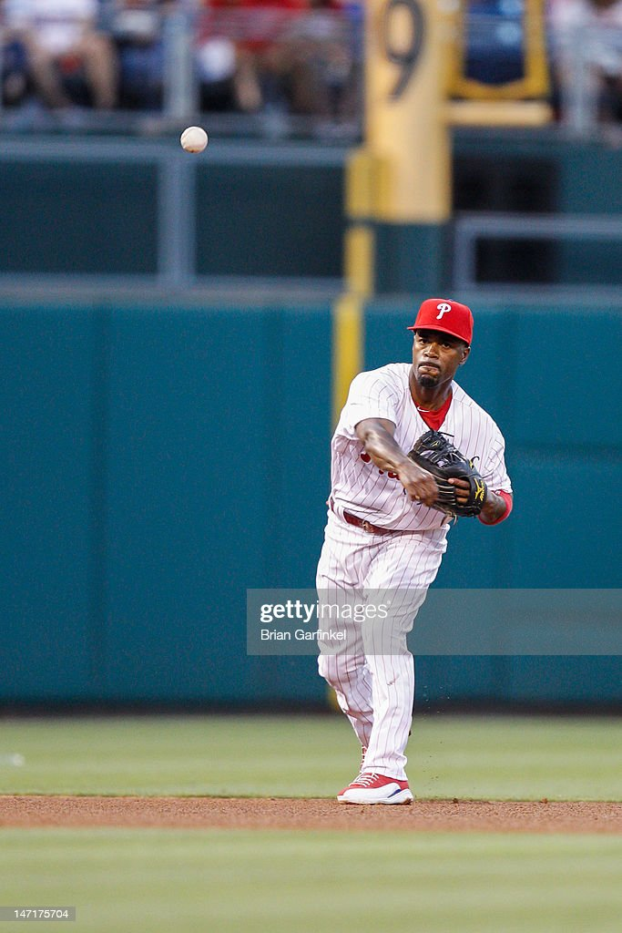 <a gi-track='captionPersonalityLinkClicked' href=/galleries/search?phrase=Jimmy+Rollins&family=editorial&specificpeople=204478 ng-click='$event.stopPropagation()'>Jimmy Rollins</a> #11 of the Philadelphia Phillies throws the ball to first in the fourth inning of the game against the Pittsburgh Pirates at Citizens Bank Park on June 26, 2012 in Philadelphia, Pennsylvania.