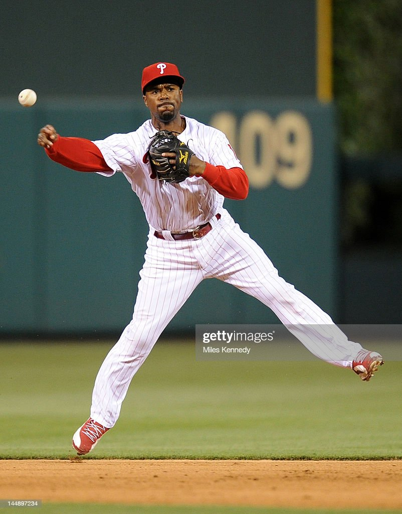 <a gi-track='captionPersonalityLinkClicked' href=/galleries/search?phrase=Jimmy+Rollins&family=editorial&specificpeople=204478 ng-click='$event.stopPropagation()'>Jimmy Rollins</a> #11 of the Philadelphia Phillies throws to first base against the Boston Red Sox in the ninth inning on May 18, 2012 at Citizens Bank Park in Philadelphia, Pennsylvania. The Phillies won 6-4.