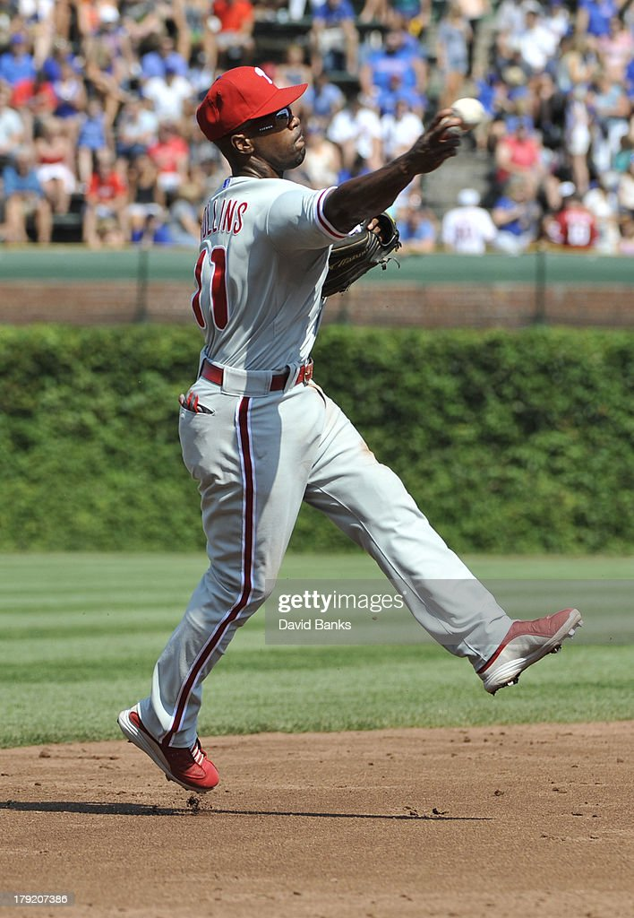<a gi-track='captionPersonalityLinkClicked' href=/galleries/search?phrase=Jimmy+Rollins&family=editorial&specificpeople=204478 ng-click='$event.stopPropagation()'>Jimmy Rollins</a> #11 of the Philadelphia Phillies tries to make a play on an infield single by Starlin Castro #13 of the Chicago Cubs during the third inning on September 1, 2013 at Wrigley Field in Chicago, Illinois.