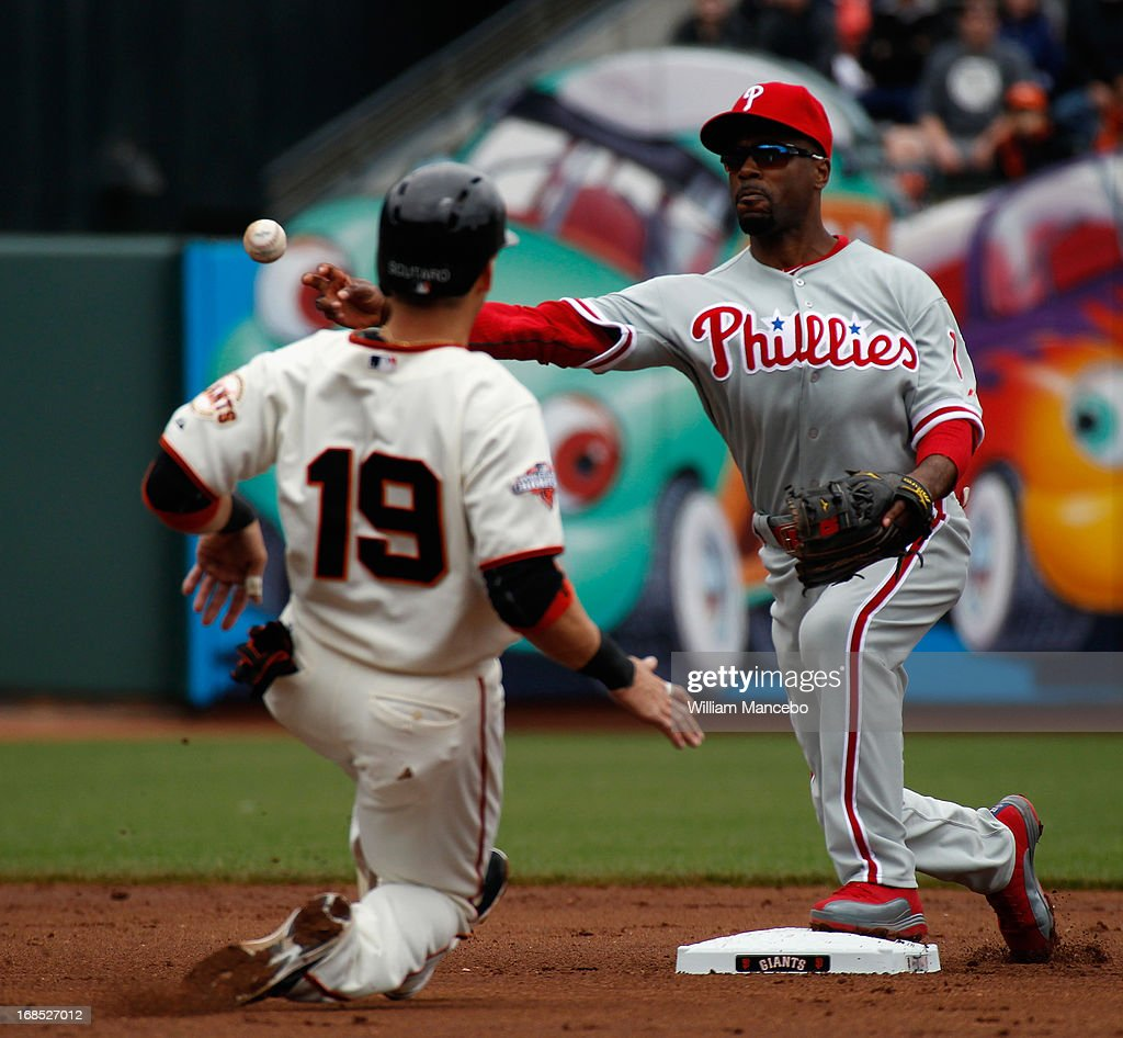 <a gi-track='captionPersonalityLinkClicked' href=/galleries/search?phrase=Jimmy+Rollins&family=editorial&specificpeople=204478 ng-click='$event.stopPropagation()'>Jimmy Rollins</a> #11 of the Philadelphia Phillies tries to turn a double play after forcing out <a gi-track='captionPersonalityLinkClicked' href=/galleries/search?phrase=Marco+Scutaro&family=editorial&specificpeople=239523 ng-click='$event.stopPropagation()'>Marco Scutaro</a> #19 of the San Francisco Giants at AT&T Park on May 8, 2013 in San Francisco, California.