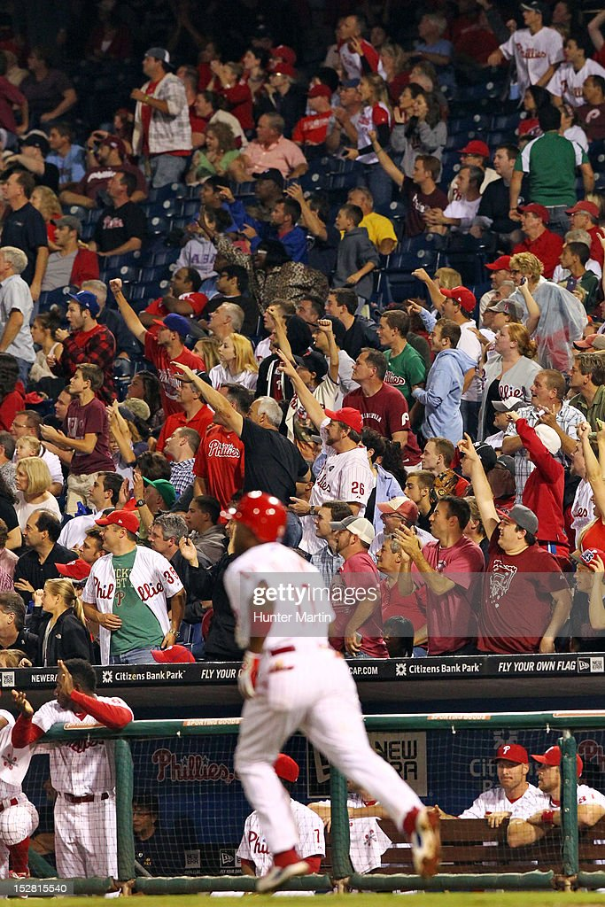 <a gi-track='captionPersonalityLinkClicked' href=/galleries/search?phrase=Jimmy+Rollins&family=editorial&specificpeople=204478 ng-click='$event.stopPropagation()'>Jimmy Rollins</a> #11 of the Philadelphia Phillies watches his home run as fans cheer during a game against the Washington Nationals at Citizens Bank Park on September 26, 2012 in Philadelphia, Pennsylvania. The Nationals won 8-4.