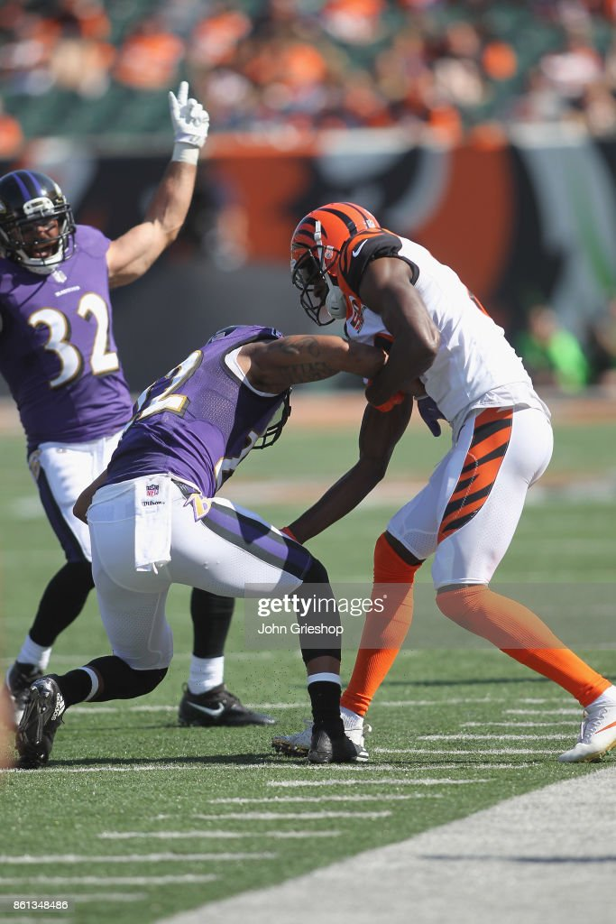 Jimmy Smith #22 of the Baltimore Ravens intercepts the football in front of A.J. Green #18 of the Cincinnati Bengals during their game at Paul Brown Stadium on September 10, 2017 in Cincinnati, Ohio.The Ravens defeated the Bengals 20-0.