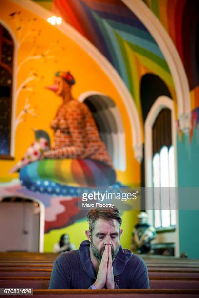 Jimmy Smrz of Denver Colorado spends a quiet moment reflecting in the chapel at the opening of the International Church of Cannabis on April 20 2017...