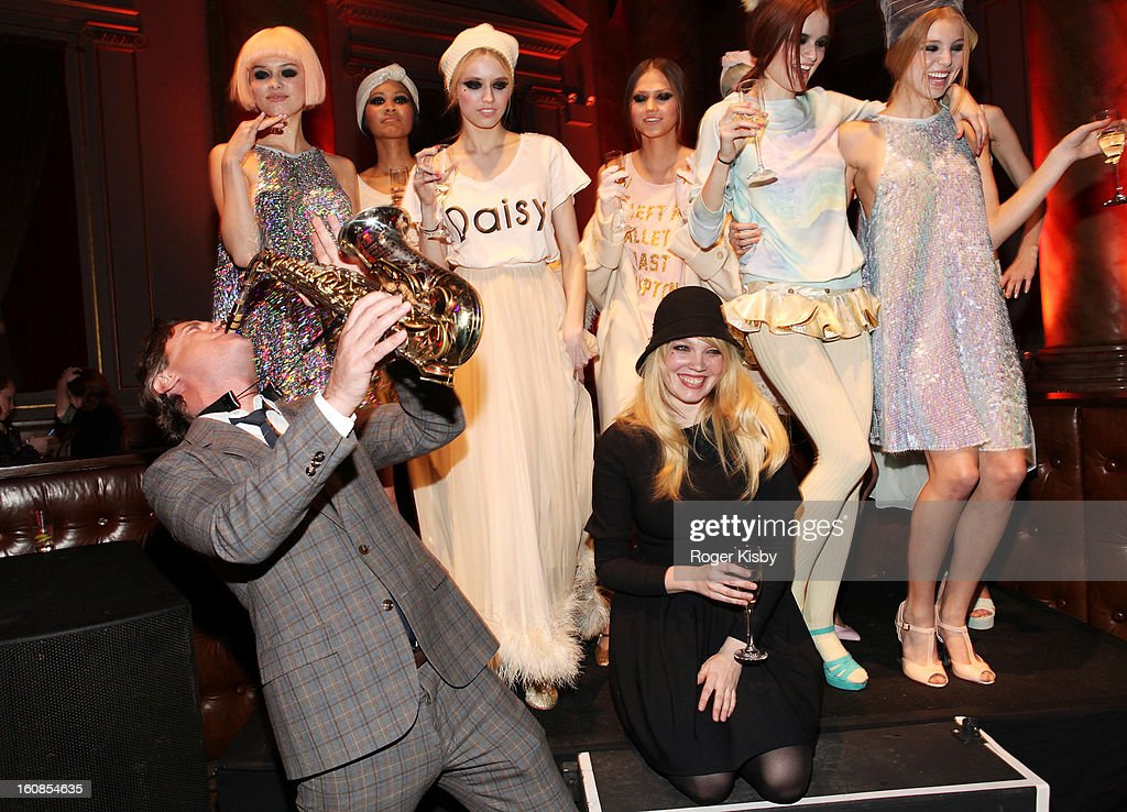 Jimmy Sommers plays the saxaphone with Wildfox designer Kimberly Gordon at the Wildfox Fall 2013 Collection Presentation & Live Performance at Capitale on February 6, 2013 in New York City.