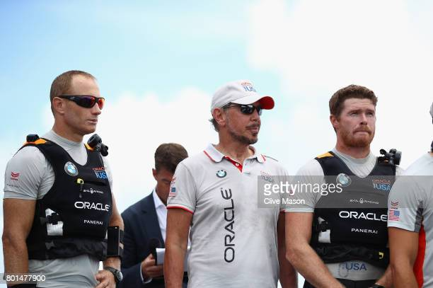 Jimmy Spithill Larry Ellison and Tom Slingsby of Oracle Team USA look on as Emirates Team New Zealand win race 9 against Oracle Team USA to win the...