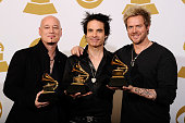 Jimmy Stafford Pat Monahan and Scott Underwood of the band Train winners of the Best Pop Performance By A Duo Or Group With Vocals award for ''Hey...