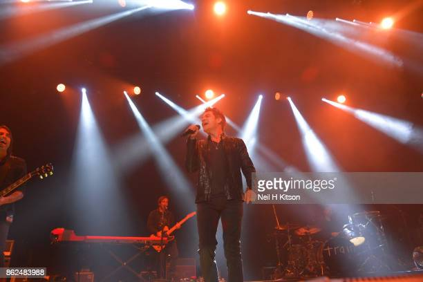 Jimmy Stafford Patrick Monahan Drew Shoals of Train perform at City Hall on October 16 2017 in Sheffield England