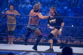Jimmy 'Superfly' Snuka looks on as WWE Superstar Chris Jericho battles 'Rowdy' Roddy Piper during WrestleMania 25 at Reliant Stadium on April 5 2009...