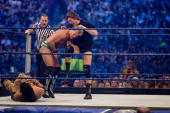 Jimmy 'Superfly' Snuka rolls out of the ring as WWE Superstar Chris Jericho battles 'Rowdy' Roddy Piper during WrestleMania 25 at Reliant Stadium on...