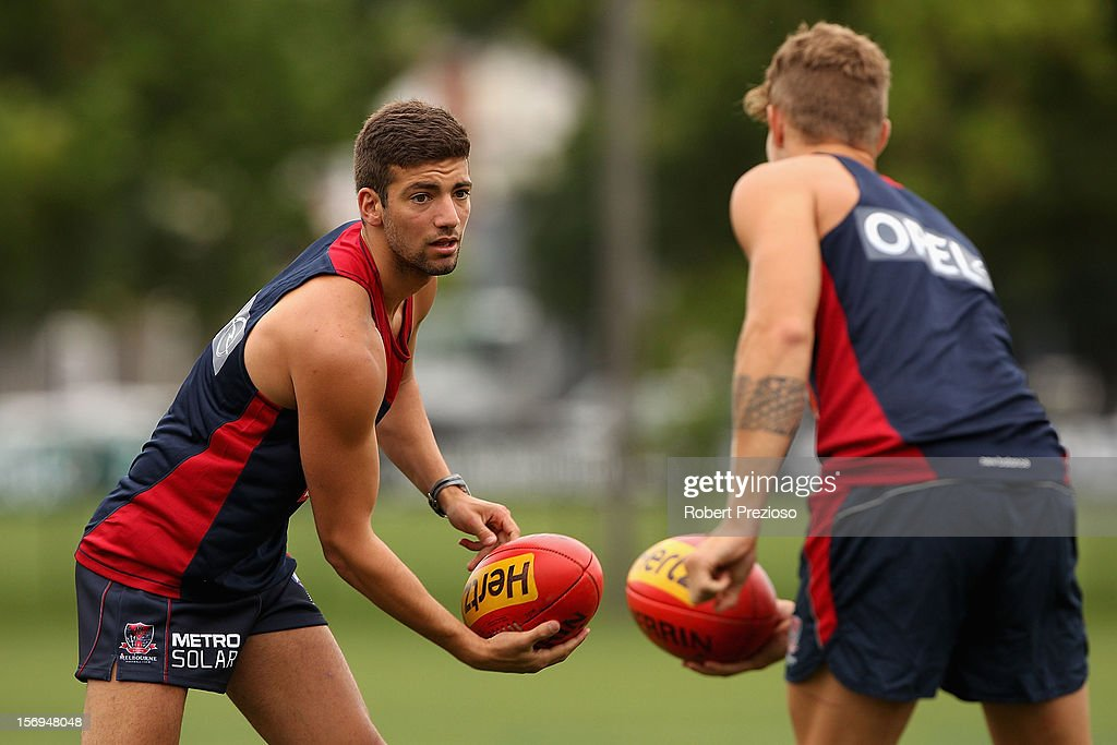 Jimmy Toumpas handballs during a Melbourne Demons AFL pre-season training session at Gosch's Paddock on November 26, 2012 in Melbourne, Australia.