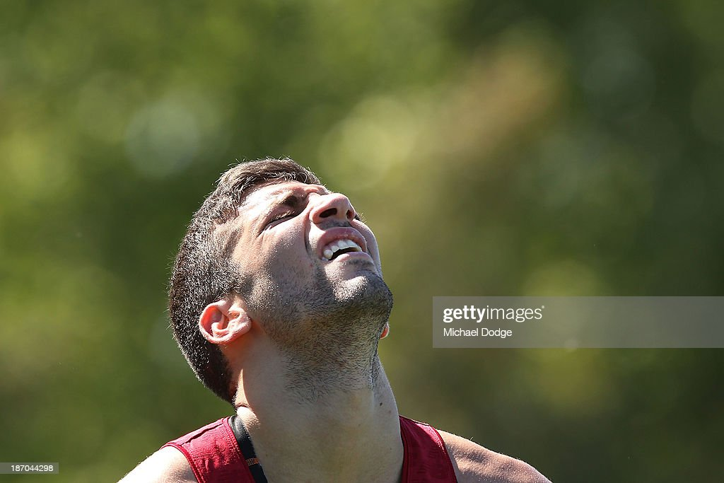 Jimmy Toumpas reacts after a hard run during a Melbourne Demons AFL training session at Gosch's Paddock on November 6, 2013 in Melbourne, Australia.