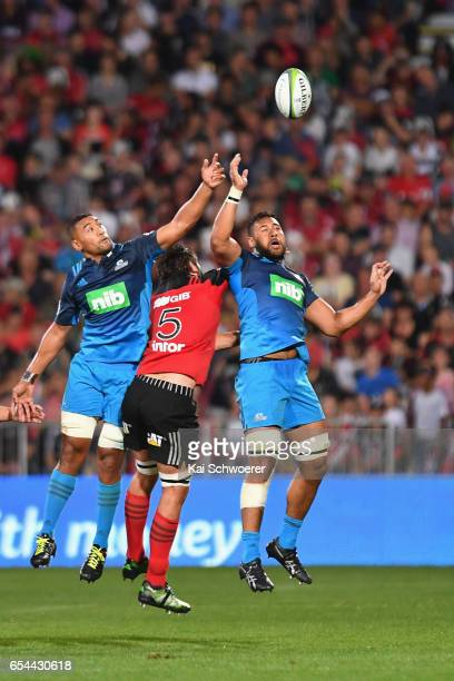 Jimmy Tupou of the Blues Samuel Whitelock of the Crusaders and Patrick Tuipulotu of the Blues compete for the ball during the round four Super Rugby...