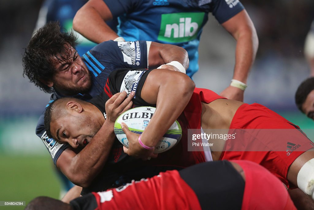 <a gi-track='captionPersonalityLinkClicked' href=/galleries/search?phrase=Jimmy+Tupou&family=editorial&specificpeople=9490071 ng-click='$event.stopPropagation()'>Jimmy Tupou</a> of the Crusaders is tackled by <a gi-track='captionPersonalityLinkClicked' href=/galleries/search?phrase=Steven+Luatua&family=editorial&specificpeople=6164979 ng-click='$event.stopPropagation()'>Steven Luatua</a> of the Blues during the round 14 Super Rugby match between the Blues and the Crusaders at Eden Park on May 28, 2016 in Auckland, New Zealand.