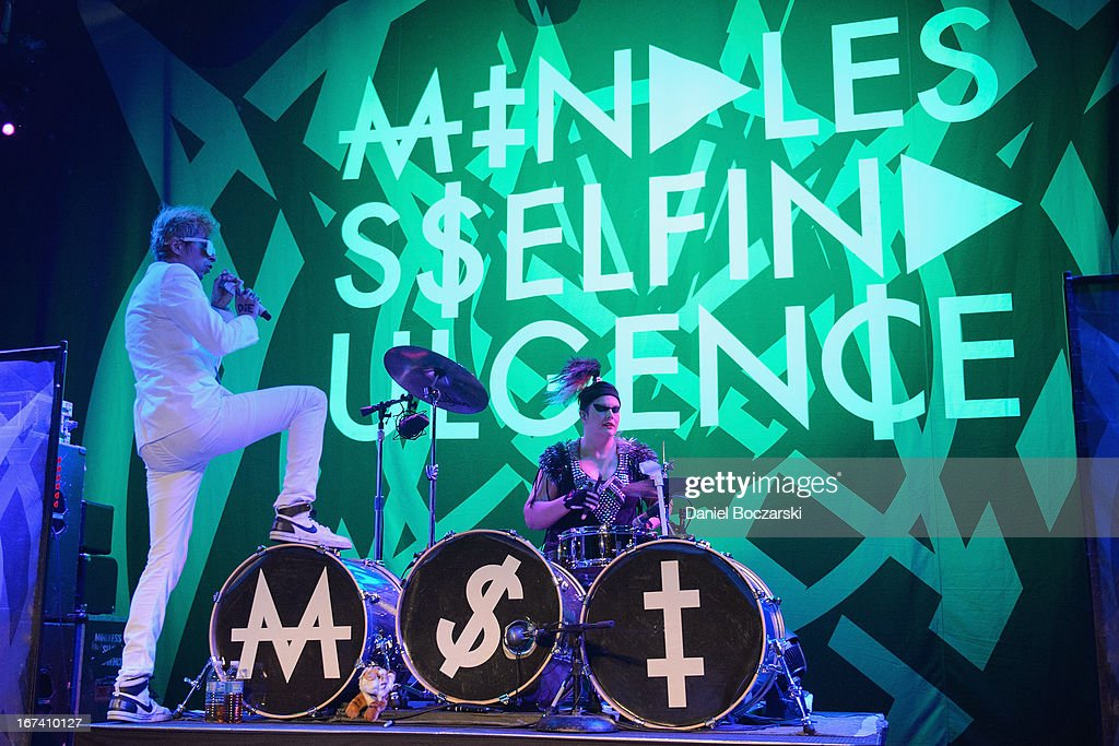 Jimmy Urine and Kitty of Mindless Self Indulgence perform on stage at House Of Blues Chicago on April 24, 2013 in Chicago, Illinois.