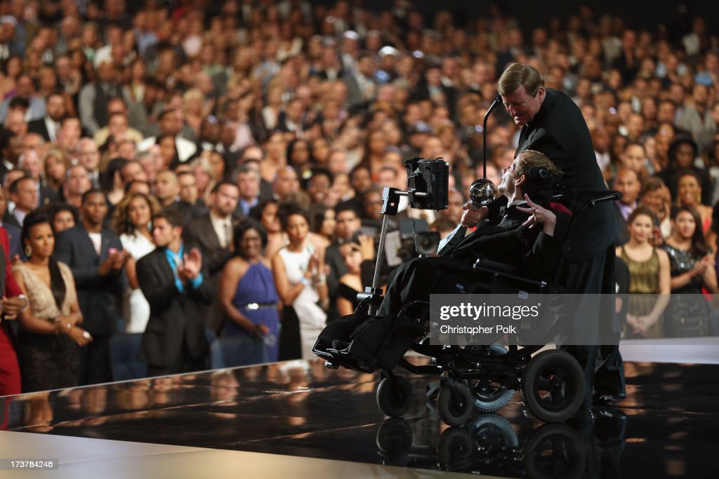 Jimmy V award recipients Dick Hoyt and son Rick Hoyt accepting an award onstage at The 2013 ESPY Awards at Nokia Theatre L.A. Live on July 17, 2013 in Los Angeles, California.