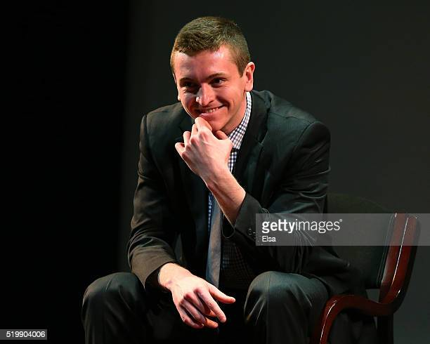 Jimmy Vesey of Harvard University and Hobey Baker Award winner listens as his father is interviewed on stage during the 2016 Hobey Baker Memorial...